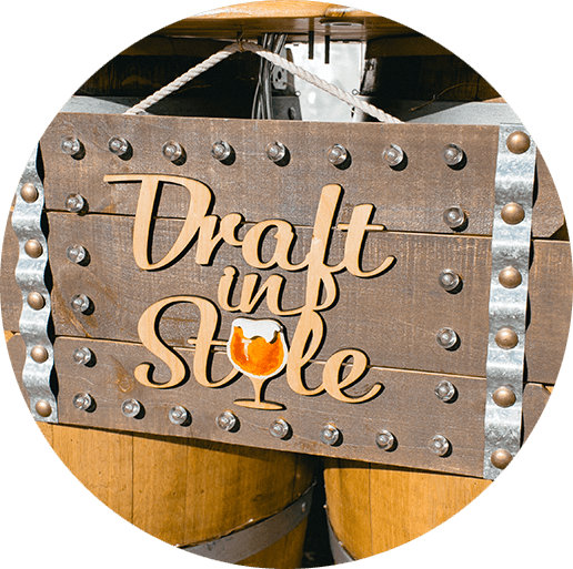 Draft in Style sign on kegs.