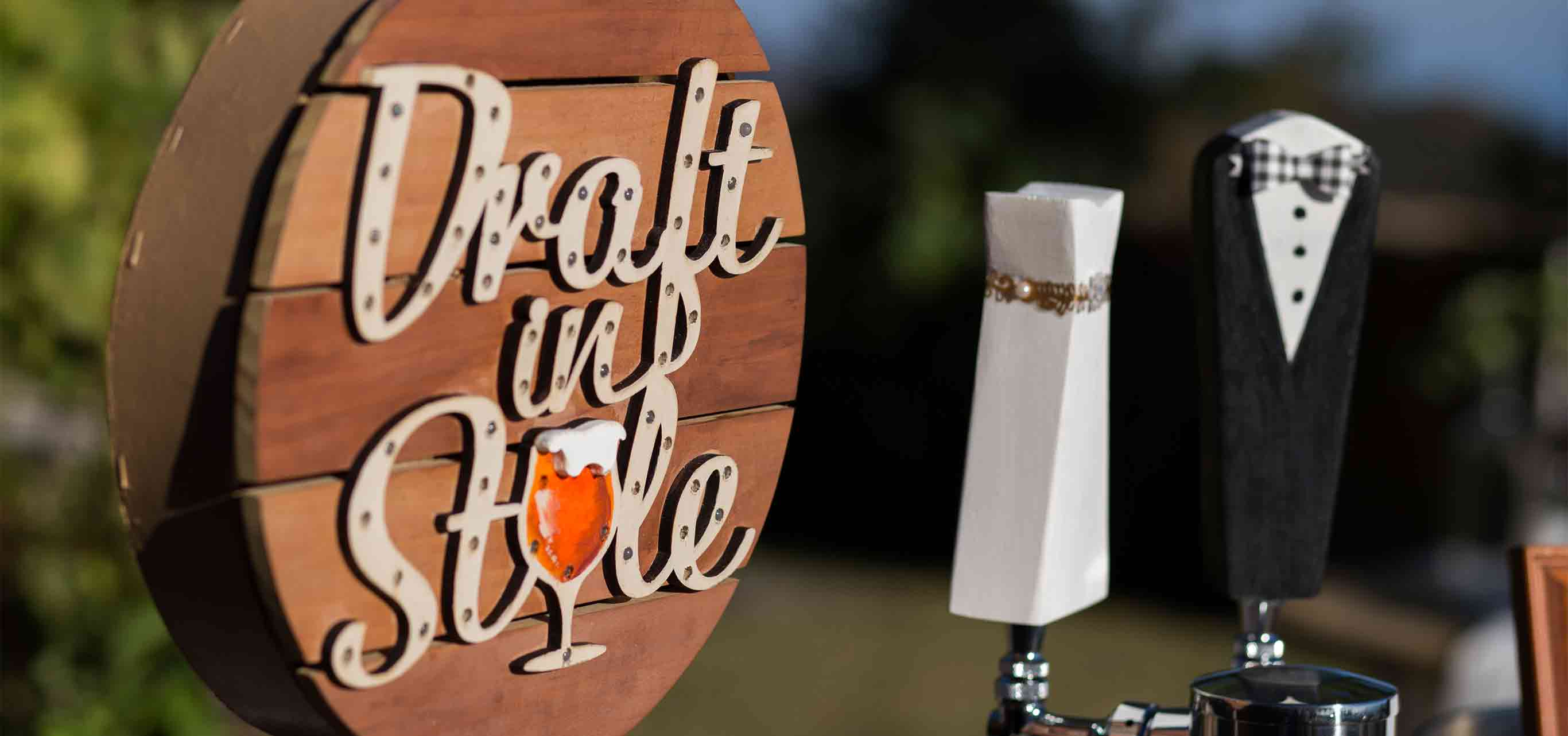 Draft In Style sign with Wife and Groom Beer Tap Handles